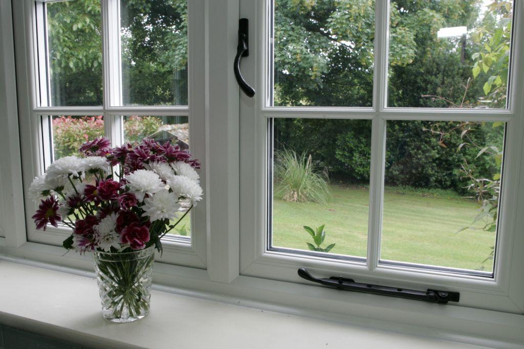 White wood bars window